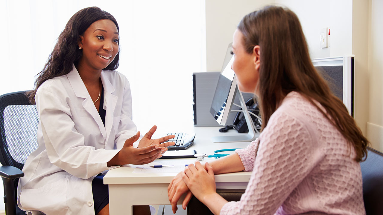 Health specialist meeting with patient