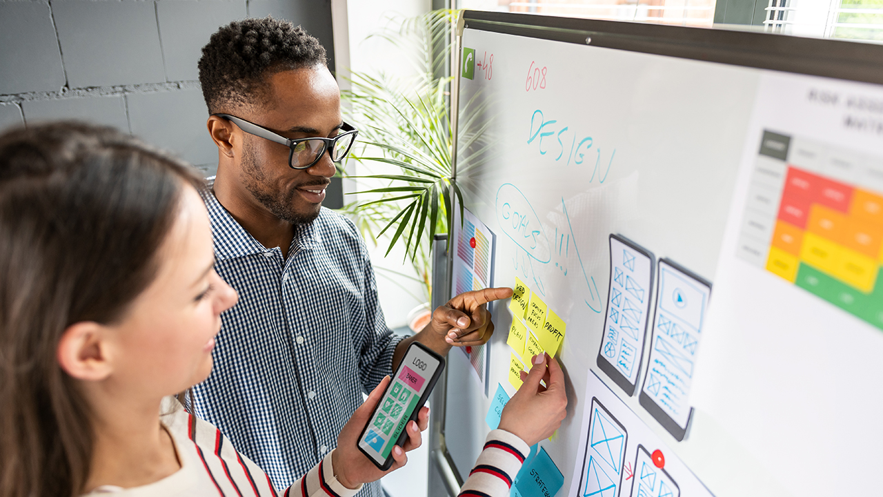 Professionals collaborate to improve user experience in healthcare.