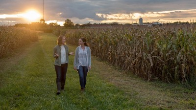 Two people in discussion while walking through a field