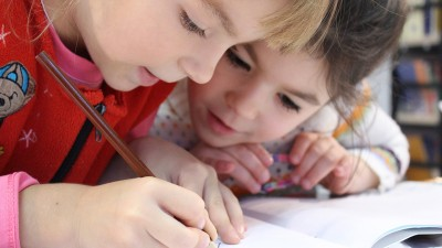 Two young children working together