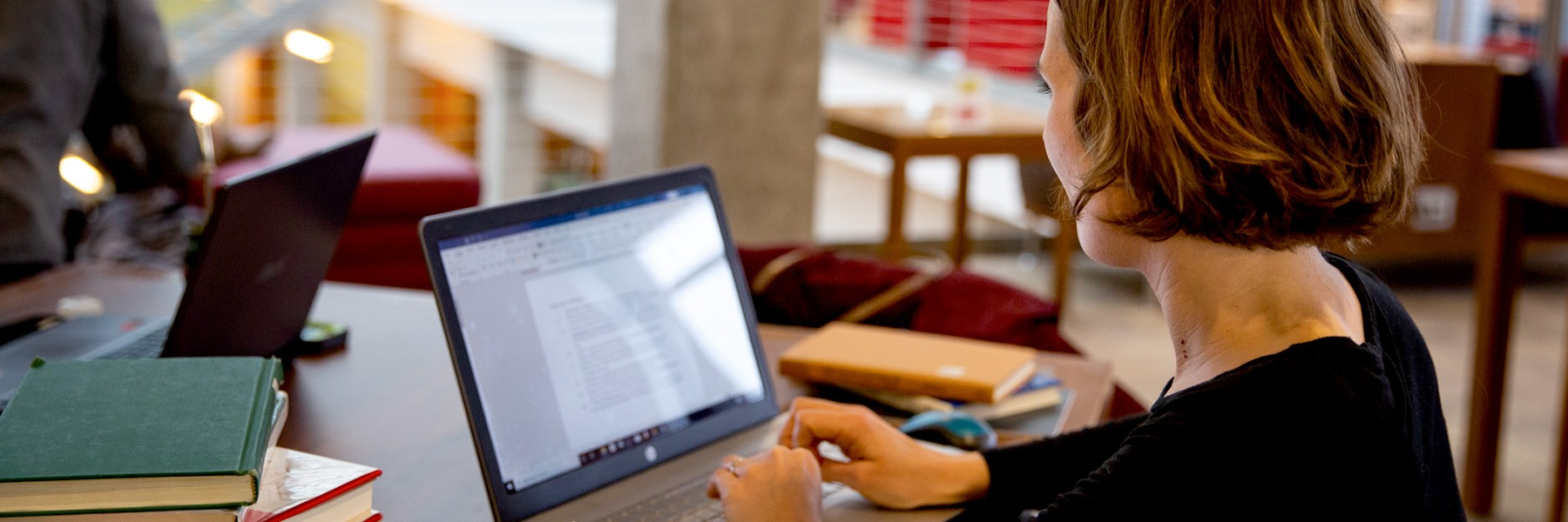 Woman using a laptop in a library