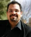 A headshot of Professor Timothy Huerta